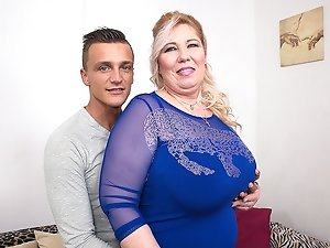 Big breasted mature BBW fucking her toy boy