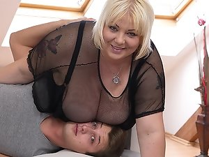 Hot housewife shows off her huge tits and does her toyboy