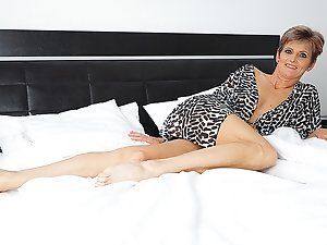 Horny housewife playing in bed