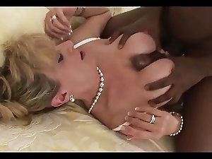 Big titted mature thakes it rough.