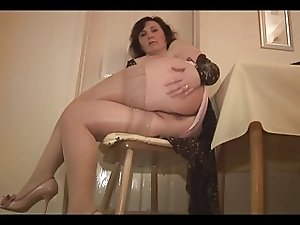 Busty mature English Milf strips and teases