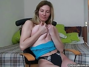 Blonde soccer mom shows her big tits and wanton pussy