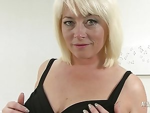 Mature Amber Jewel wearing sexy black stockings