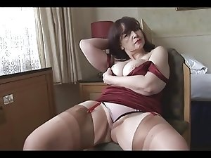 Big tits mature milf shows off sheer panties