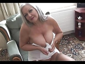 Attractive busty graanny in open girdle
