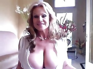 mature lady with gigantic titties plays with vibrator