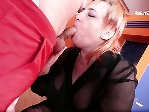 Chubby redhead mature gobbling a cock